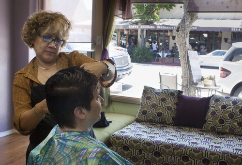 Salon owner Blanca Moore has been cutting customer Leslie Averill's hair for two years. Averill learned about Moore through her daughter and says that she drives to La Verne from Pasadena to come to Moore's shop, Bebe's Family Hair Design, because Moore gets to know her customers hair and does a great job. Bebe's is located at 2119 Third Street, across the street from Caffé Allegro. / photo by Stephanie Ball