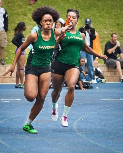 Freshman Nasjua Palmer and junior Ebony Williams race to a third place finish in their heat at the women's 4x100 relay at the 27th Annual Pomona-Pitzer Track and Field Invitational Saturday at Strehle Track in Claremont. The women's team remains undefeated in SCIAC play. The next scheduled event for La Verne is today at the Bryan Clay Invitational in Azusa. / photo by Chelsea Knight