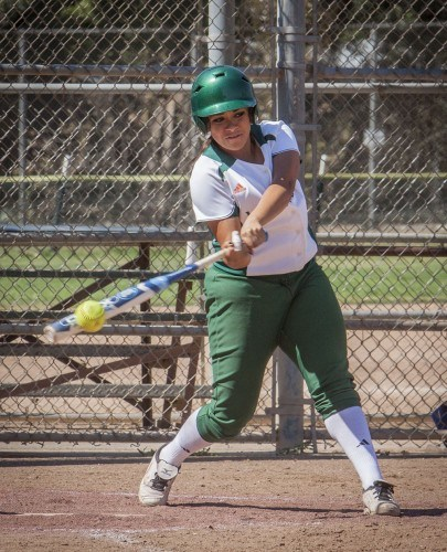 Junior communications major Candice Nuñez went to bat at the bottom of the second inning against Pomona-Pitzer, where she hit a single. La Verne won both games in their double-header home game at Wheeler Park on April 19, trouncing the Sagehens on their senior day. / photo by Stephanie Ball
