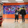 During a warm-up session, Soetan Osifeso, 19, tries a few tricks while Jose Carerra, 18, and Soyemi Osifeso, 15, watch and wait for their turn to show off. The Hip Hop School of Arts in Pomona is a unique space that features lessons on how to DJ, create modern street art, and dance in a variety of hip-hop styles. The school is located on the southwest corner of Garey Avenue and Holt Boulevard in Pomona. The school's executive director Julio Cesar Rivas leads the new program, inaugurated Feb. 27. The school is in partnership with the Boys & Girls Club of the Pomona Valley.  / photo by Chelsea Knight