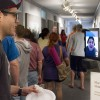 "At the reception for ""Geolocation: Desert­scapes,"" senior communications major Anthony Juarez speaks to featured photographer Marni Shindelman via Skype and an iPad because the photographers could not make it to the reception. The exhibit, also featuring the work of Nate Larson, runs through May 24 in the Carlson Gallery on the ground floor of Miller Hall. / photo by Ryan C. Gann"