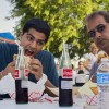 Devan and Sanjay Pandya take a break from school and work to enjoy a meal at the weekly food truck fest at Glendora Friends Church. The Glendora-based church just started this weekly event, along with Freddy's Food Court, an online company that supplies food trucks and catering services to organizations in the greater Los Angeles area. / photo by Christopher Mora