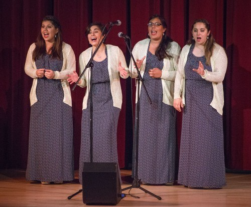 """Ladies of Leo – a group comprised of junior liberal studies major Melissa Molinaro, sophomore music and theatre arts major Mona Lutfi, sophomore photography and theatre arts major Sonora Hernandez and junior music major Amanda Timko – perform """"I Don't Mind,"""" """"On My Own,"""" and """"Ma, He's Making Eyes At Me"""" The at the barbershop harmony concert May 9 in Morgan Auditorium. / photo by Nicole Ambrose"""