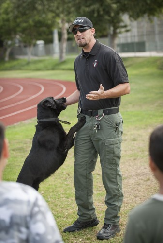 Officer J. Wells of the K-9 Unit walked with his canine, Maverick, for the La Verne Police Department's Walk With a Copevent at Bonita High School on Saturday. Families registered children to walk the track with officers and learn about civic history. / photo by Hunter Cole