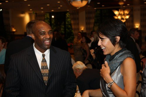 Will Darity chats with inductee Liz Lucsko at the 2009 Athletics Hall of Fame induction ceremony. Darity, the University's sports information director, died suddenly Wednesday at the age of 43. / file photo by Rafael Anguiano