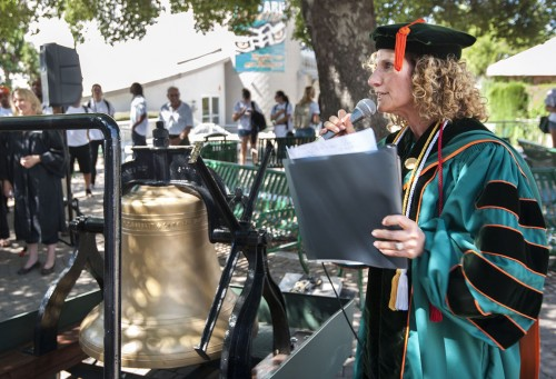 """The ringing of the spirit bell marks the beginning of the academic school year, calling everyone to Convocation. President Devorah Lieberman addresses the student body, faculty and staff before ringing the bell as the """"Call to the Leo Community."""" / photo by Hunter Cole"""