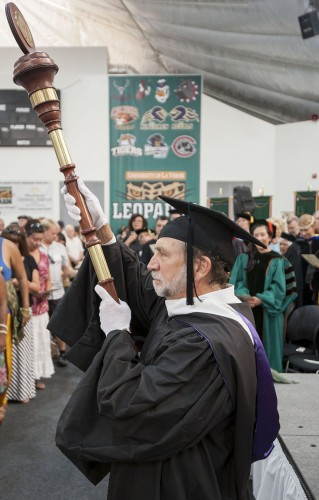 As the processional begins, Professor of Photography Gary Colby carries the University mace and leads the train of faculty and staff off the court to end the ceremony. / photo by Hunter Cole