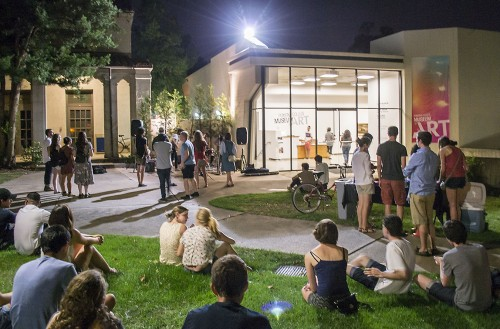 Students from the Claremont Colleges gather at the opening of Art After Hours Sept. 5 at the Pomona College Museum of Art. At 9 p.m. students stopped and listened to a band before heading to one of the four galleries. The exhibition includes photographs of performance art and slow motion videos of dancers, recording the fluidity and minute details of human movement. Art After Hours is hosted by Pomona College from 5 p.m. to 11 p.m. every Thursday through Dec. 5. / photo by Sarah Golden