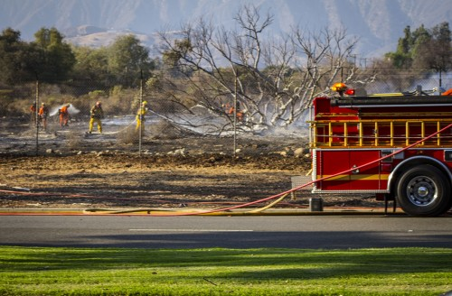 Fire fighters battle a blaze that started at approximately 3:40 p.m. Wednesday, just north of Foothill Boulevard between Mills and Amherst avenues in Claremont. It took more than 150 fire fights from the Claremont and  County fire department roughly two hours to extinguish the fire, which consumed 17 acres of property owned by the Claremont Colleges. After the fire was out, fire fighters remained on site well into the night to extinguish any remains of the fire. / photo by Ryan Gann