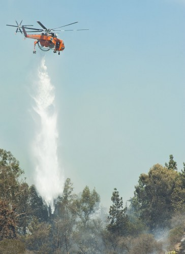 On Friday afternoon a brush fire broke out in La Verne near Broken Spur Lane above Baseline Avenue. The fire burned nearly 27 acres of land and destroyed at least one structure despite the efforts of firefighters on the ground and aircraft dropping water. The Erickson Aircrane helicopter can carry up to 2,650 gallons of water for fire fighting. / photo by Hunter Cole