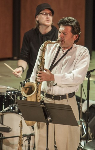 "Saxophonist Steve Alaniz and alum drummer Mike Bennett perform the piece ""Potawatomi Trail"" with the Reed Gratz Band Sunday in Morgan Auditorium. This concert was the first of a series called ""Sundays at the Morgan."" / photo by Stephanie Ball"