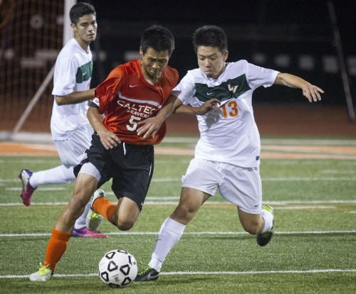 La Verne sophomore midfielder Ko Yajima battles it out for the ball with Caltech senior midfielder Thomas Kwok shortly after Yajima scored the third goal in La Verne's victory Wednesday at Ortmayer Stadium / photo by Ryan Gann