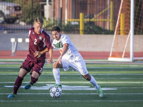 During the second half of Saturday's game, freshman forward Mario Interiano of La Verne drives the ball away from Chapman freshman forward Daniel Friedman and back up field. The Leopards defeated the Panthers, 4-1. / photo by Sarah Golden