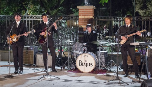 "Sgt. Peppers, a Beatles tribute band, performed Tuesday night on the Davenport Dining Hall patio and played a variety of the Beatles' hits such as ""I Want to Hold Your Hand,"" ""Yellow Submarine"" and ""Hey Jude."" Dan Carson imitates Paul McCartney, David Kaufman plays George Harrison, Jim Laspesa is Ringo Starr and Don Mendonca portrays John Lennon. Police stopped the show early due to noise complaints. / photo by Nicole Ambrose"