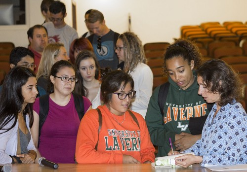 """Elizabeth Kolbert is the author of the 2013 Freshman La Verne Experience book """"Field Notes From A Catastrophe."""" After the lecture, Miranda Chavez and Gaby Moura-Hayes, both freshmen, lined up to get their books signed in the Morgan Auditorium. / photo by Uyen Bui"""