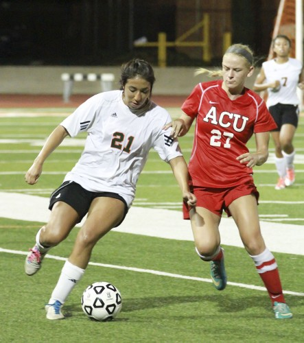 Olga Saldivar, senior criminology major, scores the first goal of the first preseason game against Arizona Christian. The Leopards won, 2-0. The women's soccer team is looking to turn around a 4-11-2 record from last year. The next home game will be against Hope International at 7 p.m. Wednesday at Ortmayer Stadium. / photo by Jessica Harsen