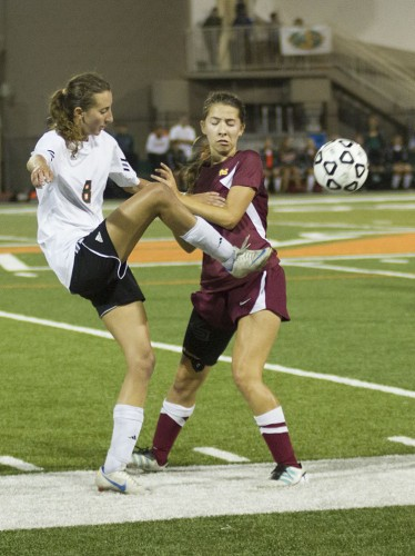 Leopard junior midfielder Jaime Weaver tries to push past Claremont-Mudd-Scripps defender Laura Hayward for a last effort at a goal before the end of the second half. After going into double overtime, the teams remained in a scoreless tie. / photo by Jessica Harsen