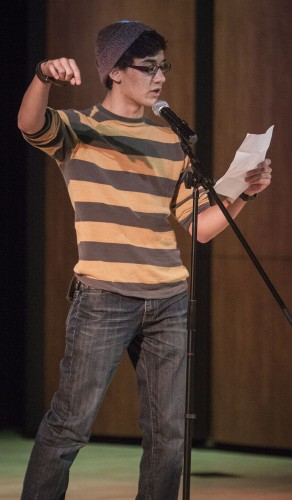 Freshman biology major Kandinsky Maraquin auditions for the Slam Team, the University's poetry club, Oct. 3 in Morgan Auditorium for his first time and goes onto the next round. Another tryout date will be announced to finish auditions for the team due to lack of publicity. / photo by Stephanie Ball