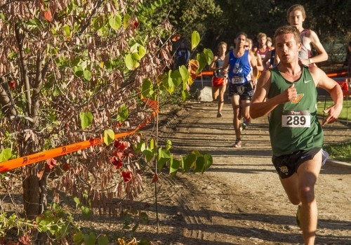 Junior kinesiology major Jayden Earlywine runs the second mile of the 8-kilometer Pomona-Pitzer Invitational cross country race Saturday. He finished 84th in a field of 165 runners, with a time of 27:46.2. The men's cross country team took sixth place out of 13 teams with a team average time of 26:44.98. The women's team finished in 11th out of 12 teams. / photo by Ryan Gann