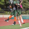 Senior running back Matthew Biggers and senior quarterback Justin Gomez celebrate Biggers' scoring of the last touchdown in the final minutes of the fourth quarter. Biggers had 25 rushing attempts and rushed for a team high 117 yards. Biggers averaged 4.4 yards a carry and the Leopards rushed for a total of 311 yards. La Verne's next game is the Homecoming game at 1 p.m. Saturday against Whittier. / photo by Helen Arase