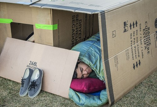 Robert Guzman, a Damien High School student, sleeps outside in a cardboard box for Pomona Valley Habitat for Humanity to raise awareness of the homeless. The event was hosted by the University of La Verne and held in the South Quad from Saturday night to Sunday morning. Volunteers from the Alpha Omicron Pi sorority began setting up their communities at 6 p.m. and helped monitor the students participating in the event. / photo by Uyen Bui