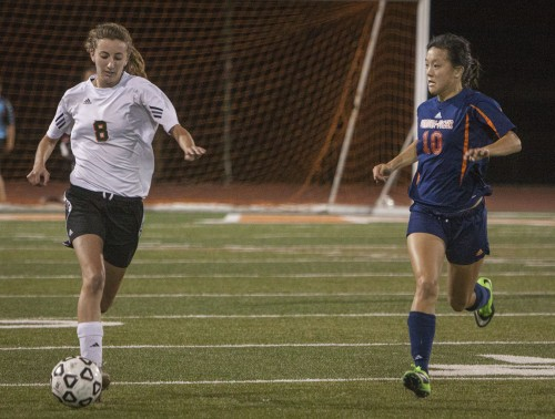 In the first half Saturday, junior midfielder Jaime Weaver drives down the field toward Pomona-Pitzer's goal as Sagehens midfielder Allie Tao tries to steal the ball. The game ended with a 4-1 loss for La Verne. / photo by Stephanie Ball