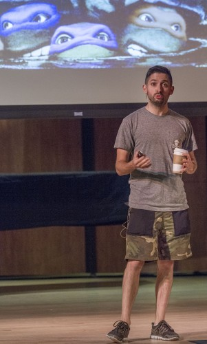 """Johnny Earle, known professionally as Johnny Cupcakes for his clothing brand, speaks about his business journey Tuesday in Morgan Auditorium. Johnny Cupcakes advertises itself as """"An Unordinary Bakery"""" because it sells t-shirts, not cupcakes. / photo by Celine Dehban"""