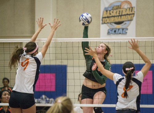 Junior outside hitter Nysa Allen spikes the ball past Pomona-Pitzer's Kirea Mazzolini and Ellen Yamasaki, scoring for the Leopards in the second set. The Leopards won the second set but lost the match to the Sagehens, 3-1. / photo by Sarah Golden