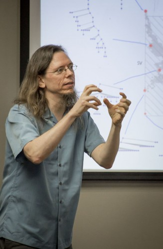 Associate Professor of Physics David Chappell explains entropy in the form of a tree chart at a joint faculty lecture with Provost about entropy Monday in the President's Dining Room. Chappell said entropy is important to enable an organization to function properly. / photo by Uyen Bui