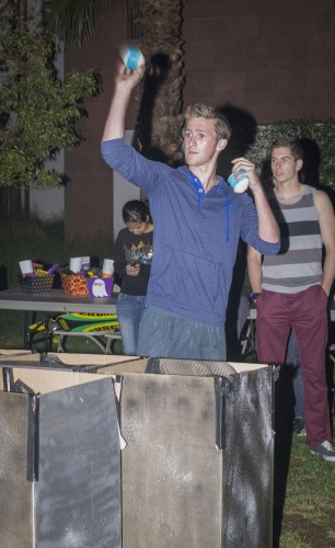 "La Verne student Jason Nicholls wins the fifth match of the Monster Pong tournament Tuesday in the first stage. Nicholls eliminated his opponent's monster ""cups"" first by shooting the ball into them. The Campus Activities Board hosted the tournament on the South Quad. / photo by Helen Arase"