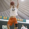 Junior center Niall Harrison competes in a slam dunk contest against his basketball teammates. This was one of many contests preformed as a part of Moonlight Madness at Frantz Athletic Court Oct. 24. Hosted by CAB, the event kicks off the upcoming basketball season.