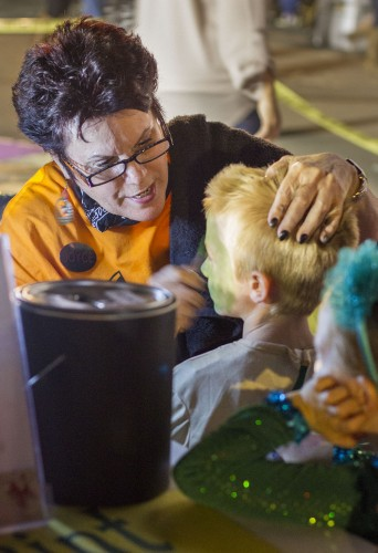 Joyce Quisenberry from Clown Connection volunteered to run a face-painting booth at Grace Miller Elementary School's Fall Festival Oct. 25. It was put on by the schools Parent Teacher Association. Several members of the La Verne community volunteered to help at the event. / photo by Celine Dehban