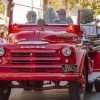 Charlie Farrell, from La Verne Fire Department, drives an antique La Verne fire truck carrying Board of Trustee member Mary Ann Melleby in the Homecoming Parade Saturday. The parade, which began at the Hanawalt House, included the Bonita High School marching band, club floats and the Homecoming Court. Club booths also competed for prizes. / photo by Jessica Harsen