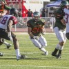 Garrett Mentz, sophomore running back, carries the ball midfield and charges against Chapman's defense in the fourth quarter of Saturday's home game. La Verne lost to Chapman, 45-7. La Verne's last home game of the season is Saturday against Cal Lutheran.