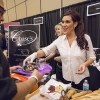 Jennifer Ciancia, an employee of Chase's on Third Street in downtown La Verne, provides samples from the menu to guests at the 13th Taste of La Verne at the Sheraton Fairplex Conference Center Saturday. The Taste of La Verne event features samples of food, wine and a variety of other alcohols from restaurants around and near La Verne. / photo by Nicole Ambrose