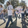 Angie Anderson, associate director of Student Life, walked alongside Steve Anderson during Monday's Veteran's Day Parade on Magnolia Avenue toward Veteran's Hall, at the corner of Magnolia and Bonita Avenue. The Andersons were followed by sophomores Chris Gonzalez and Kellie Galentine, who carried art drawn by students at the University of La Verne. / photo by Uyen Bui