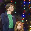 Erin Friedeman, who works at the La Verne City Hall, and her daughter Margaret watch the Bonita High School choir perform at City Hall on Monday at the city of La Verne's annual tree lighting ceremony. Margaret, a Roynon Elementary School second-grader, was chosen to light the tree at the ceremony. See story on page 3. Photo By: Celine Dehban