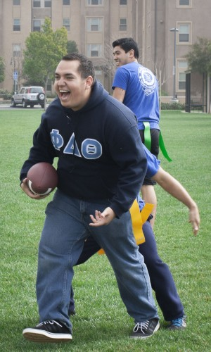 teven Santana, president of Phi Delta Theta, and his fraternity brothers play a game of flag football on the South Quad on Wednesday for Rush Week. Santana made the catch, but his flags are pulled immediately afterward. / photo by Austen Beck