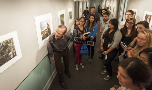 "The first showing of the spring semester in the Irene Carlson Gallery of Photography entitled ""Natural History"" by photographer Traer Scott is a collection of candid portraits captured in the reflection off the glass at the American Museum of Natural History. Professor Al Clark discusses the photographs with his honors colloquium class while other students and faculty spoke with Scott over webcam. The gallery will be on display until April 4, 2014 on the bottom floor of Miller Hall. / photo by Hunter Cole"
