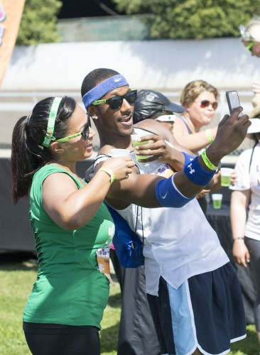 Stacey and Damon Devine take a selfie before taking their first drink at the Tap 'N' Run 4K event March 15 at the Fairplex. Participants, many dressed in costume, drank a cup of beer at four stations throughout the run, including a can of beer upon completion. / photo by Daniel Hargis