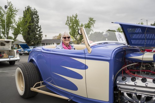 Patty Lyons waits for her husband, Richard, in their 1932 Ford Roadster at the Bonita High School Car Show. Bonita hosted its third annual auto show Saturday, with the proceeds going to the high school's automotive technology program. The event featured dozens of classic cars, hot rods and international imports. / photo by Amanda Nieto