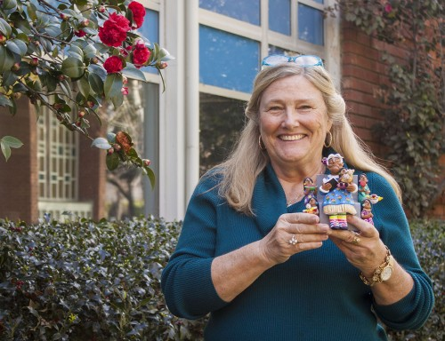 """Kim Martin, professor of anthropology, loves collecting dolls and traveling the world. One of her favorite decorations in her office is a clay sculpture of a storyteller she got in Oaxaca, Mexico. It was made by a woman artist who worked with few raw materials to make many sculptures for tourists. Martin says that the sculpture is beautiful because it """"symbolizes generations passing down wisdom."""" Martin loves this sculpture because it reminds her of herself, she is a storyteller, a teacher, and a grandmother of three boys. / photo by Stephanie Ball"""