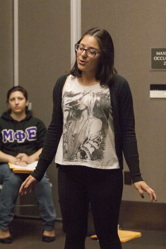 "Freshman biology major Abril Casias sings a Bruno Mars song at day one of La Verne Idol auditions March 26. Casias got the ""golden ticket"" to go on to the next stage of the competition. The finals will be April 17. / photo by Stephanie Ball"