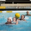 La Verne junior utility Amber Tardif loses her cap as she advances the ball toward the Claremont-Mudd-Scripps goal during the second quarter of the game at the Matt M. Axelrood Pool at CMS Saturday. The Leopards trailed most of the second half, and ultimately lost to the Athenas, 10-8. / photo by Helen Arase