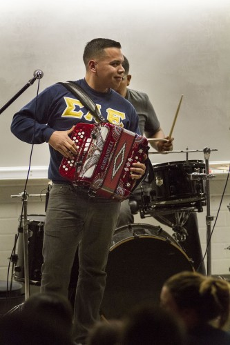 "Senior international business major Jose Ruelas plays ""Me Gustas Mucho"" on the accordion for the Phi Sigma Sigma talent show Tuesday in LaFetra Lecture Hall. Money raised from the talent show go to the Neddie Scholarship, which helps Phi Sigma Sigma members around the nation pay for college. / photo by Jessica Harsen"