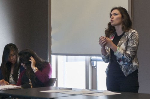 Gia Karpouzis, sophomore philosophy major, argues that women who pose for Playboy Magazine are doing great harm to the feminist movement. She spoke after her partners, Mary Anne Mendoza, senior political science major, and Marissa Solomon, senior political science and speech communication major. The debate team hosted a public debate Wednesday about the morality of posing for Playboy in honor of Women's History Month. / photo by Katie Madden