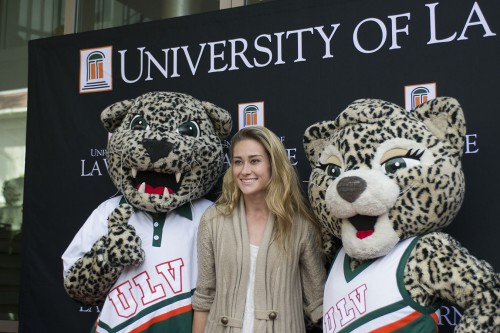 Brittany Logan, an Auckland, New Zealand native, poses for a photo with Leo and Lea after walking down the red carpet at the start of Spotlight Weekend outside of the Campus Center on April 4. Spotlight Weekend welcomed potential incoming students to the University, where they had a chance to get a closer look at campus life and stay in a dorm. / photo by Daniel Hargis