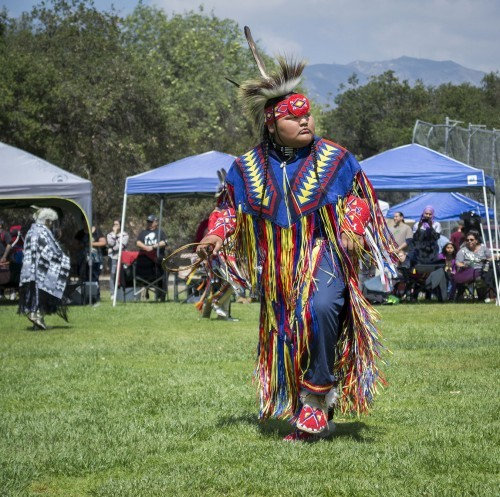 Abel Jacome joins other dancers for the Second Annual Honoring the Elements Powwow at Pomona College Saturday. The northern host drum, The Wildhorse Singers, and the southern host drum, The Northridge Boys, performed traditional and contemporary Native American songs. Community members were invited to join the dancers during the intertribal pieces. The event was held in honor of the ancestors and to harmonize with tribal homelands. / photo by Amanda Nieto