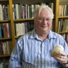 When he is not teaching history at the University of La Verne, history professor Stephen Sayles also enjoys professional baseball. In his office, among the multitude of political and historical texts, is an acrylic sealed baseball. It is signed by Negro American League first baseman Buck O'Neil and was a gift from some of his past students. Photo by/ Julien Burrell