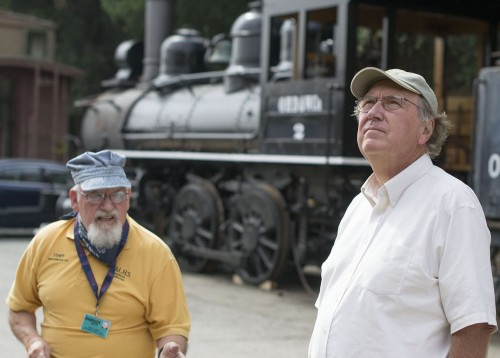 Gary Fazekas of Salinas, Calif., examines an old Union Pacific locomotive with Jesse Tomory, the chief docent at the Rail Giants Train Museum, last Saturday at the Fairplex. The Rail Giants Train Museum houses a numerous retired locomotives, some of which house museums and train related antiques inside. The trains are restored by donations from the public. / photo by Daniel Hargis